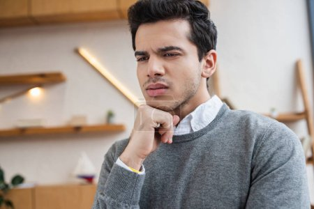 Portrait of thoughtful businessman in office