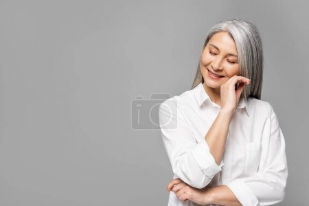 beautiful happy asian woman with grey hair isolated on grey