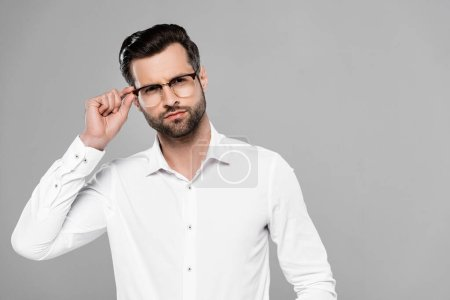 Photo for Handsome businessman touching glasses isolated on grey - Royalty Free Image