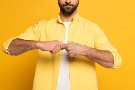 Cropped view of man showing word friend in deaf and dumb language on yellow background