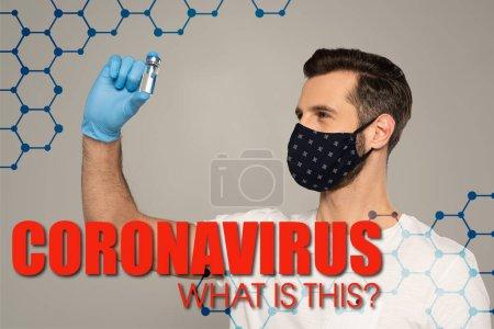 Photo pour Masque de sécurité pour homme tenant un pot de vaccin isolé sur un coronavirus gris quelle est cette illustration - image libre de droit