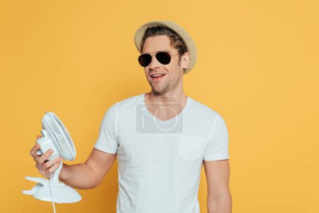 Photo for Front view of man in hat and sunglasses holding - Royalty Free Image