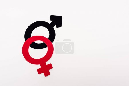 top view of red and black gender symbols isolated on white