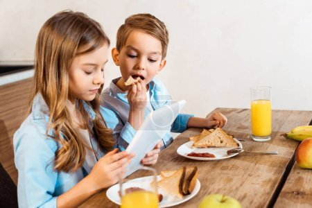 Photo for Collage of siblings e-learning and eating breakfast at home - Royalty Free Image