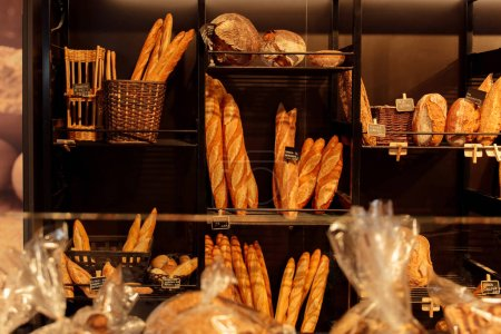 Photo for Selective focus of baguettes and bread on bakery showcase in Catalonia, Spain - Royalty Free Image