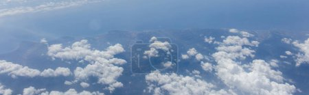Aerial view of clouds above sea and Catalonia, Spain, panoramic shot