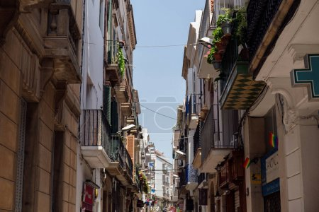 Photo for Urban street with lgbt flags and pharmacy sign in Catalonia, Spain - Royalty Free Image