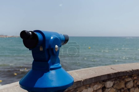 Photo for Selective focus of scenic magnifier on sea coast with sea and sky at background, Catalonia, Spain - Royalty Free Image