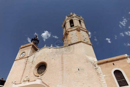 Low angle view of church of San Bartolome and Santa Tecla with blue sky at background in Barcelona, Spain