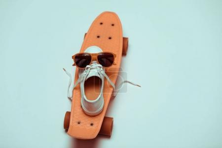 Hipster skateboard, sneaker and sunglasses