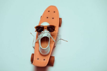 Photo for High angle view of hipster penny board, one sneaker and sunglasses making smiley composition - Royalty Free Image