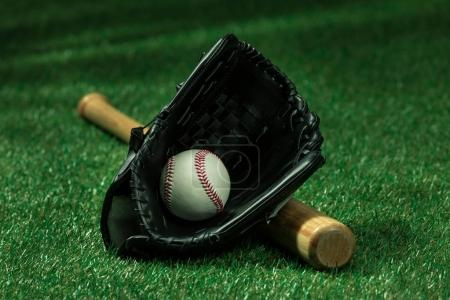 Baseball bat, glove and ball