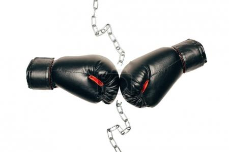 Photo for Pair of black boxing gloves with metallic chain in the middle isolated on white - Royalty Free Image