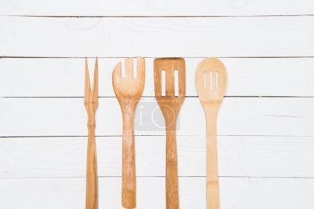 top view of various wooden spatulas on white tabletop