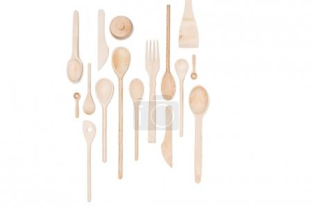 Top view of various wooden kitchen utensils isolated on white