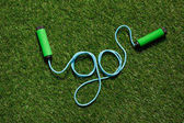 top view of skipping rope on the grass in form of word go