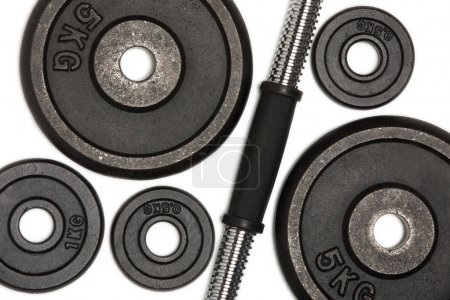 Close-up view of different weight plates for weight training isolated on white