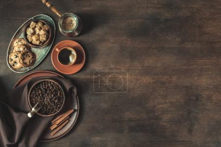 Photo for Top view of coffee with beans and brown sugar with cookies on wooden tabletop - Royalty Free Image