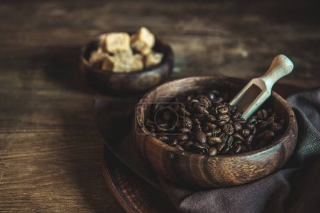 Coffee beans and brown sugar on tabletop
