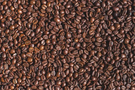 Photo for Close up of heap of roasted aromatic brown coffee beans - Royalty Free Image