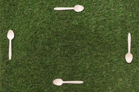wooden spoons on grass