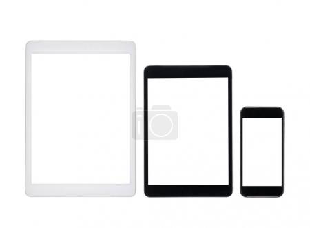 digital tablets and smartphone with blank screens