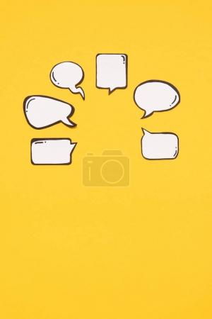 Photo for Set of various blank speech bubbles isolated on yellow background - Royalty Free Image