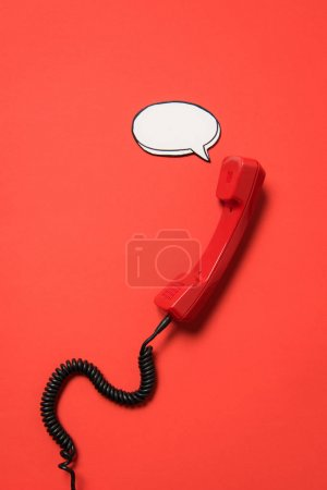 Telephone handset and speech bubble