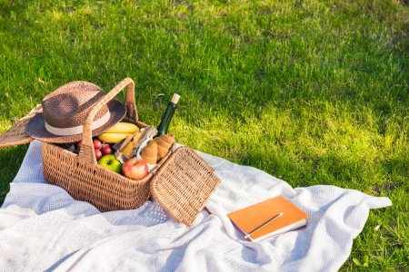 Picnic basket and notebook with pencil