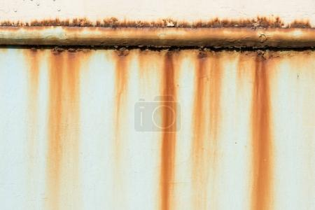 Rusty pipe on wall