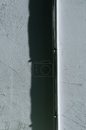 Photo for Close-up view of electrical wires on grey concrete wall background - Royalty Free Image