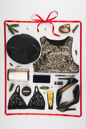Photo for Flat lay with arranged feminine festive clothes, shoes and cosmetics isolated on white - Royalty Free Image