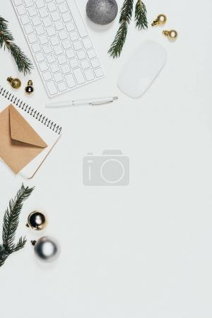 Photo for Flat lay with arranged office supplies, christmas toys and branches isolated on white - Royalty Free Image