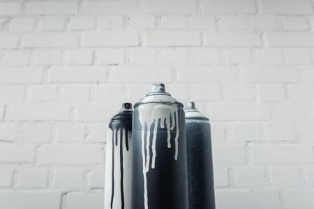 Photo for Close up view of spray paint in cans with brick wall background - Royalty Free Image