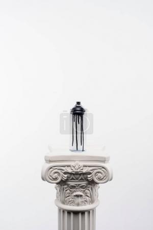 close up view of spray paint in can standing on column isolated on white