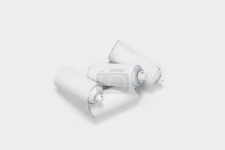 Photo for Close up view of aerosol paint in cans isolated on white - Royalty Free Image