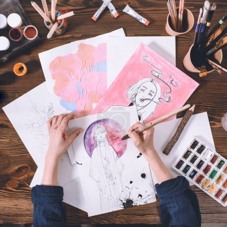 Photo for Top view of artist making sketches with watercolor paints - Royalty Free Image