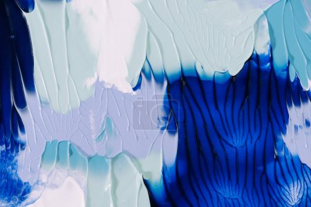 close-up view of abstract blue, grey and white painting background