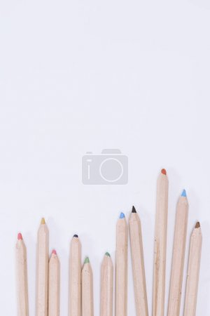 top view of colorful crayons with copy space isolated on white