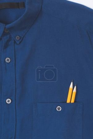 close-up view of stylish blue shirt with pencils in pocket