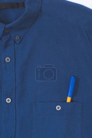 close-up view of stylish blue shirt with pen in pocket