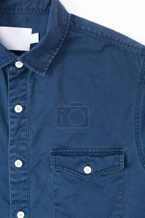 close-up view of stylish denim shirt with blank label