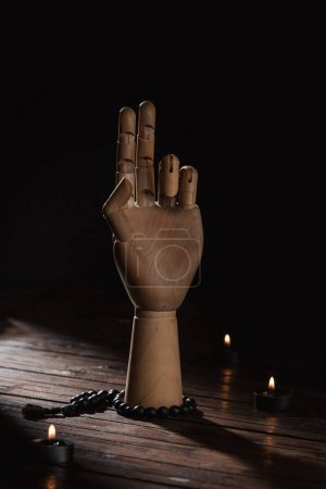 wooden hand with prana mudra gesture