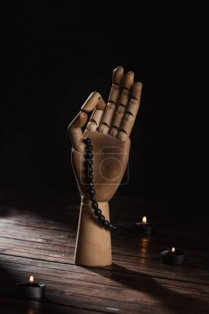 Photo for Wooden hand with gyan mudra gesture and rosary - Royalty Free Image