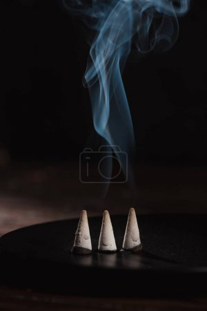 Photo for Three burning incense sticks with smoke - Royalty Free Image