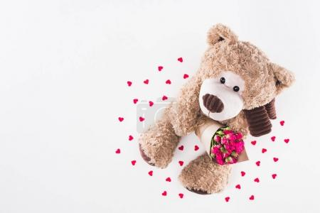 top view of teddy bear with bouquet of pink roses isolated on white, valentines day concept