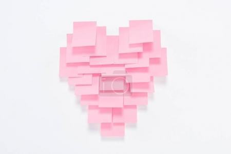 Photo for Pink paper pieces in shape of heart on white, valentines day concept - Royalty Free Image