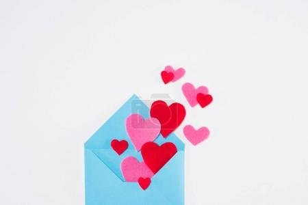 top view of blue envelope with paper hearts isolated on white, valentines day concept