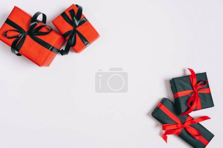 Photo for Top view of wrapped gifts isolated on grey, st valentines day concept - Royalty Free Image