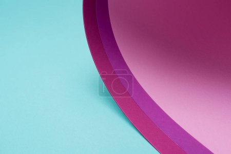 twisted pink and purple paper on turquoise